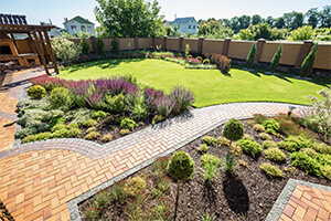 A beautifully manicured lawn and landscape maintained by professionals.